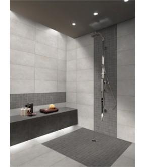 piastrella in gres color grigio scuro posata come decoro per rivestimento bagno
